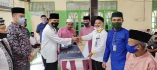 Pjs Bupati Siak Hadiri Penyaluran Zakat di Kecamatan Lubuk Dalam