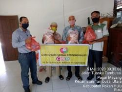 PT MAN Rohul Peduli Warga Terdampak Covid-19, Bagikan Sembako di Desa Bangun Jaya