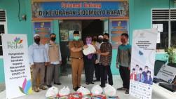 YBM PLN Riau Serahkan Bantuan Sembako ke Sidomulyo Barat